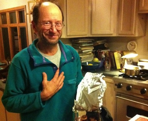 """Bass cooking grilled duck (a trial run for future """"thank you meals"""") in his home in Yaak, MT"""