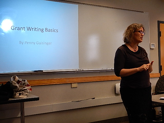 Penny Guisinger begins her talk at Bay Path University's Writers' Day.